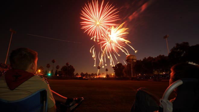 Dallin Stagg, 12, left, and Cameron Cox, 12, watch the fireworks show during the annual Fourth of July Freedom Celebration at Giant-Chevrolet-Cadillac Mineral King Bowl in 2012 in Visalia.