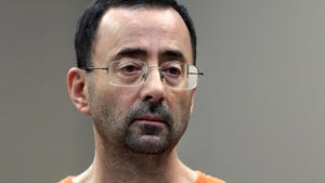 In this Nov. 22, 2017, file photo, Larry Nassar, a sports doctor accused of molesting girls while working for USA Gymnastics and Michigan State University appears in court in Lansing, Mich.