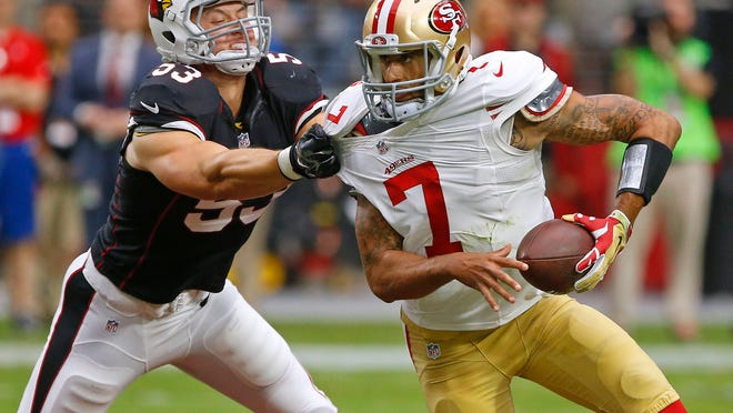 Cardinals linebacker Thomas Keiser wraps up San Francisco quarterback Colin Kaepernick.