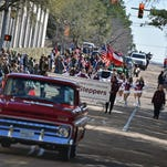 Parade-goers watch as the Dixie National Parade makes its way through downtown Jackson Saturday.