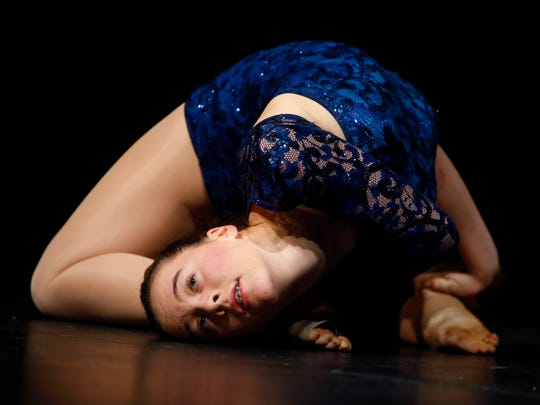 13-year-old Allison Chong of Morris Twp performs acrobatic dance routine during the Morristown Onstage auditions, taking place at Morristown High School and open to performers who live or work in the Morristown area. Finalists take the stage in front of a sell out crowd at the Mayo Center for the Performing Arts, last year, the annual show raised $126,000 for the school district. December 15, 2017. Morristown, New Jersey