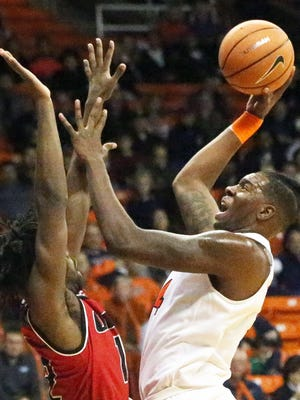 UTEP freshman Tirus Smith rises for a basket against Agustine Ene of Incarnate Word Tuesday night in the Don Haskins Center.