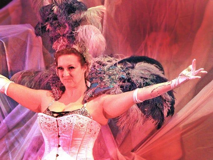 "Katie Angel takes the spotlight during dress rehearsal ""Miss Honey B's Bourbon Boyesque."""