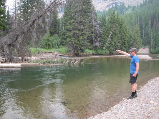 Jared White uses his tenkara fishing rod to fish the South Fork Flathead River inside the Bob Marshall Wilderness.