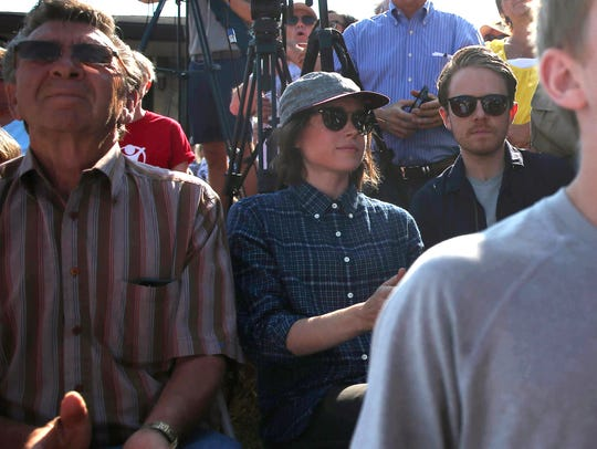Actress and activist Ellen Page sits among the crowd