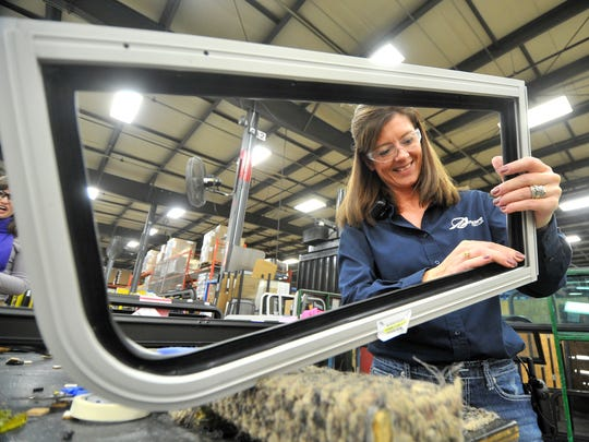 Victoria Malueg, 45, of Wittenberg, works on a transit window frame Wednesday afternoon at Arow Global in Mosinee.