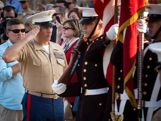 Sgt. Maj. Russell Strack salutes the flag during the