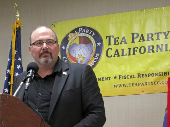 Former California Assemblyman Tim Donnelly speaks at a meeting of the California Tea Party in Fresno, Calif. He's running to represent Califoria's 8th Congressional District in the U.S. House of Representatives for the third time in 2020.