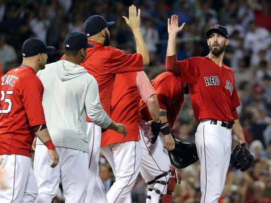Boston Red Sox players line up to congratulate starting