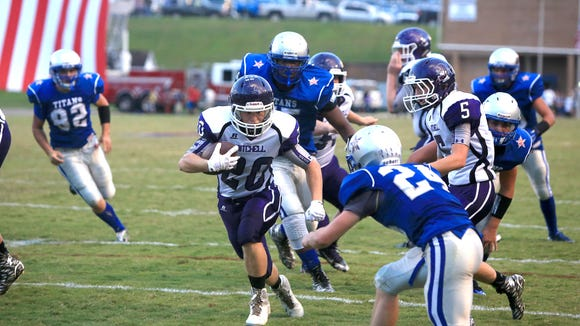 Cy Thomas (20) and Mitchell are fourth in this week's NCPreps.com state football rankings.