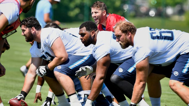 Quarterback Alex Tanney (rear middle) calls signals during Titans OTAs on Wednesday, March 31, 2017, at Saint Thomas Sports Park.