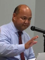 Superintendent Jon Fernandez gestures as he addresses