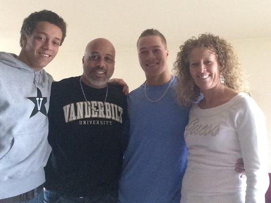 Vanderbilt's Jeren Kendall (blue shirt) with brother Justin, father Jeremey and mother Bridget.