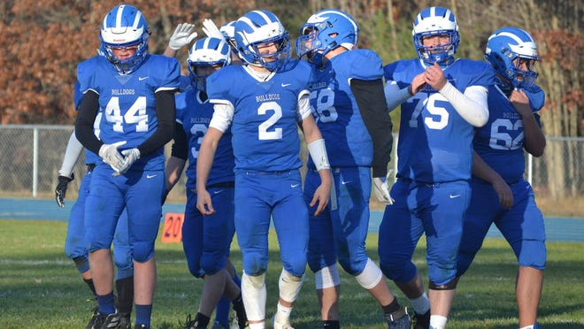 Members of the Inland Lakes offense look on during the final seconds of a contest against Munising on Saturday, Oct. 31. The Bulldogs have advanced to the 8-Player Division 1 state semifinals to play Suttons Bay. However, the contest has been suspended due to the MHSAA's decision to suspend all remaining fall sports tournaments and current winter sports activities for the next three weeks because of COVID-19 concerns.