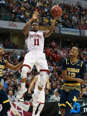 Indiana's Yogi Ferrell, #11, splits the Michigan defense during the Big Ten Conference Tournament in Indianapolis.