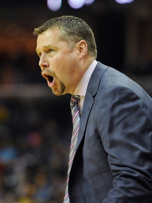 Head coach Dave Joerger of the Memphis Grizzlies yells during the second half of a game against the Golden State Warriors.