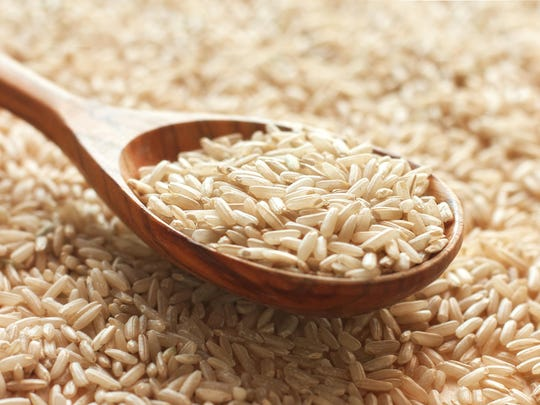 Spoon of brown rice.