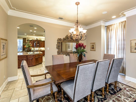 The home's formal entertaining areas feature crown