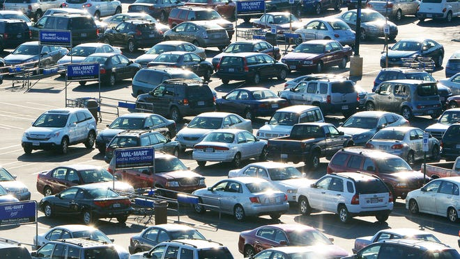"""A sea of cars in the parking lot greets """"Black Friday"""" shoppers at the Walmart in Staunton, Va., on Friday, Nov. 29, 2013."""