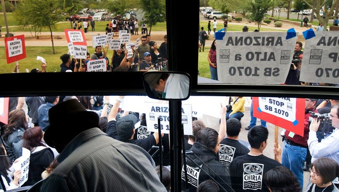 In this photo from 2010, opponents of SB 1070 arrive from California to join demonstrators at the Arizona State Capitol protesting the measure. Some travel boycotts remain, but El Paso ended its ban on Arizona travel, according to the El Paso Times.