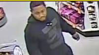 According to police, this person was one of two who broke into a vehicle and stole bank cards.