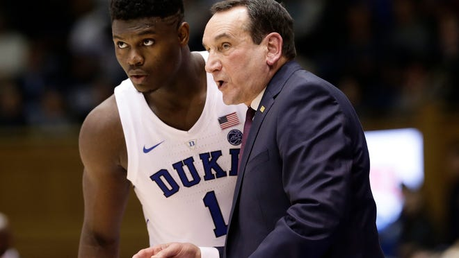 Duke's Zion Williamson (1) listens to coach Mike Krzyzewski during the first half of an NCAA college basketball game against Yale in Durham, N.C., Saturday, Dec. 8, 2018. (AP Photo/Gerry Broome)