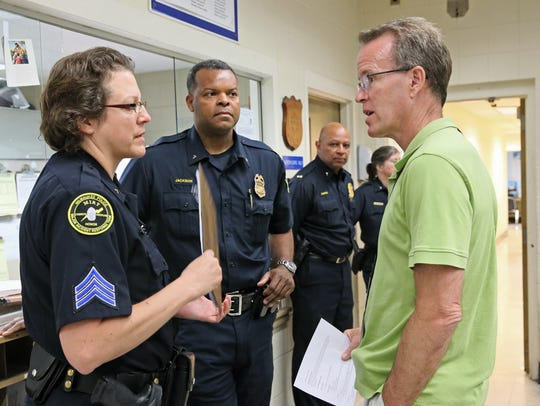 In this file photo, Steven Dykstra (right), from Milwaukee County Behavioral Health Services, talks with Sgt. Annemarie Domurat and Capt. Jutiki Jackson during the 2015 launch of a program to aid child witnesses to crimes.