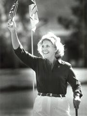 Dinah Shore waves her visor to the gallery after sinking her putt on the 15th green during the first day of the celebrity pro-am at Mission Hills Country Club in Rancho Mirage on March 31, 1987.