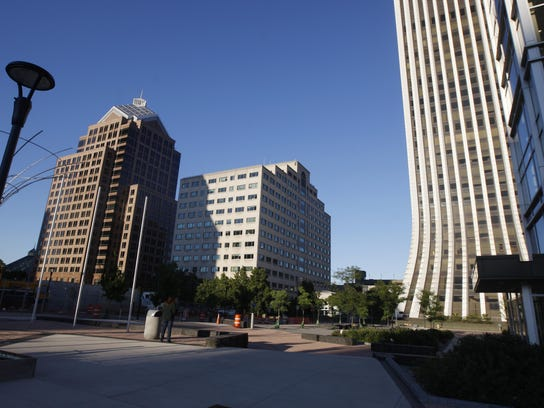 The Legacy Tower, at left, was renamed after the death