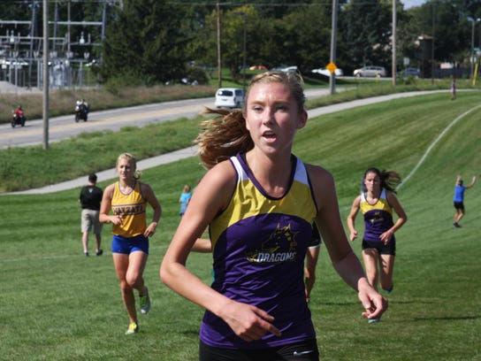 Jessica McKee charges up the hill, with Emily Poss
