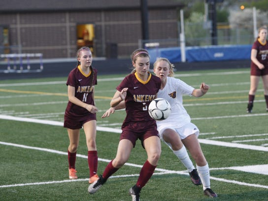 Ankeny's Morgan Bennett battles for the ball during