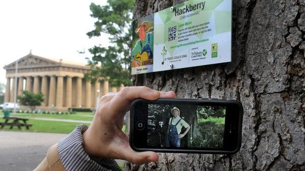 The Nature Conservancy is partnering with Metro Parks to install custom tree signs in Centennial Park that have scannable QR codes and web addresses so you can go directly via smartphone to a video of a Nashville music artists telling you about that type of tree and why it's important to us.