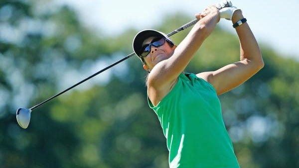 Laura Diaz watches her tee shot on the seventh hole during the first round of the Marathon Classic presented by Owens Corning and O-I at Highland Meadows Golf Club on July 17, 2014 in Sylvania, Ohio.