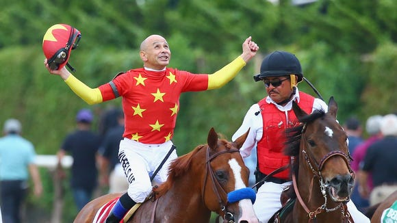 Jockey Mike Smith celebrating his Triple Crown win.