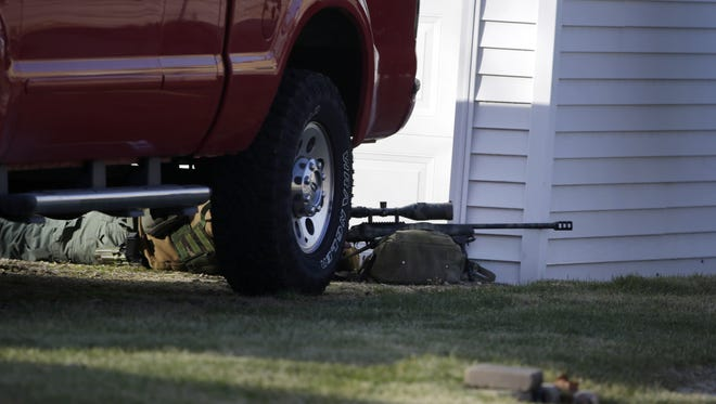 Officers respond to Saturday's hostage standoff in Neenah.
