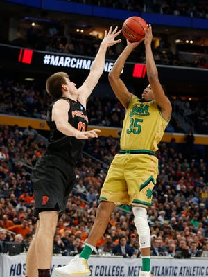 Notre Dame Fighting Irish forward Bonzie Colson (35) shoots over Princeton Tigers forward Will Gladson (13) in the second half during the first round of the NCAA Tournament at KeyBank Center.