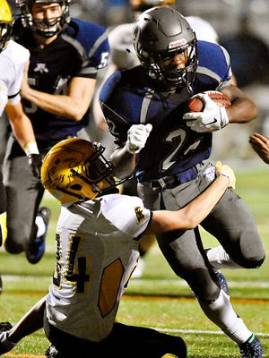 Dallastown's Zion DeVance tries to break a tackle last year vs. Red Lion. DeVance is one of several players who will take on a bigger role in 2016 to replace the all-stars who graduated from the 2015 team.