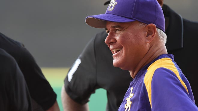 FILE - In this may 11, 2018, file photo, LSU coach Paul Mainieri speaks with game officials at home plate before the team's NCAA college baseball game against Alabama, in Baton Rouge, La. Mainieri loves the drama of the opening day knockout round of the Southeastern Conference baseball tournament. In a rare development, the Tigers will be participating in it after an up-and-down regular season.(Hilary Scheinuk/The Advocate via AP, File)
