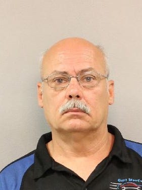 Danny Troupe, 54, is accused of dragging an officer down the interstate July 18, 2016.