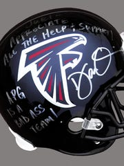 Falcons head coach Dan Quinn signed this helmet as a thank-you to Acumen Performance Group, which helped the Falcons coalesce.