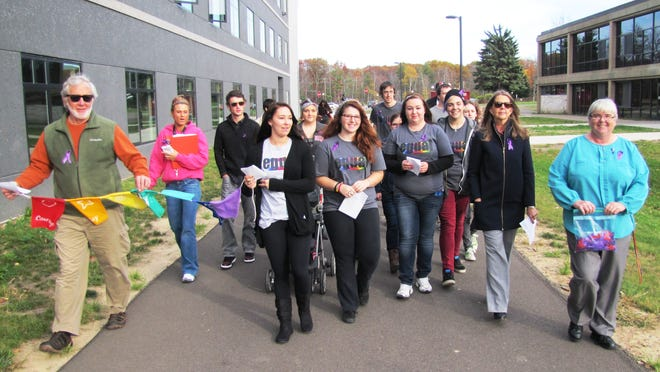 About two dozen people took part in Monday afternoon in a Take Back the Night rally against domestic violence at Corning Community College's Spencer Hill campus.