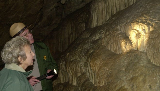 National Park Service Director Fran Mainella (left) marvels at a feature of the Oregon Caves National Monument in 2005 in Cave Junction.  AP file -  -National Park Service Director Fran Mainella, left, marvels at a feature of the Oregon Caves National Monument, Tuesday, Aug. 9, 2005, in Cave Junction, Ore., highlighted with a flashlight by tour guide Chas Davis. Mainella was making the first ever visit by a director of the national parks Service to the caves, located in southwestern Oregon. The monument faces serious maintenance issues, including refurbishing the historic Oregon Caves Chateau, and hopes to get its first two fulltime law enforcement officers. (AP Photo/Jeff Barnard)
