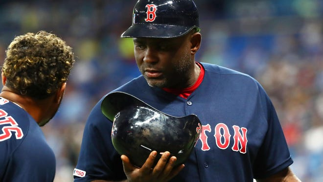 Third-base coach Carlos Febles, right, showin in a September game last season, did not travel with the Red Sox to Florida. Instead, he's back in Boston after an inconclusive coronavirus test.