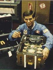Vellinger, pre-flight, with his incubator.