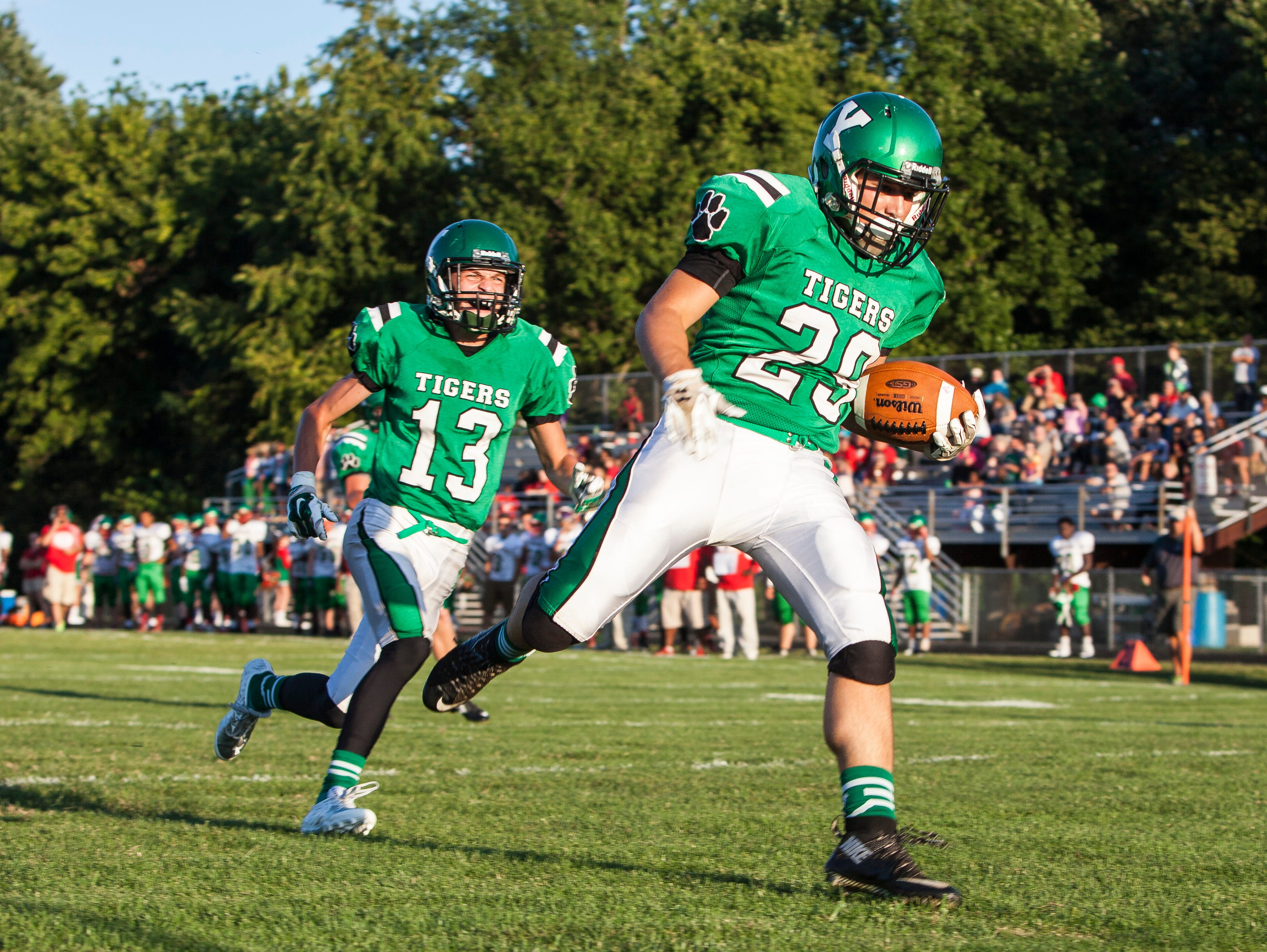 Yorktown's Jordan Spangler runs the ball in for a touchdown early in the first quarter on Friday during the home game against Anderson.