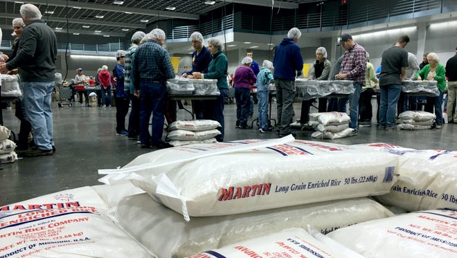Volunteers packaged about 74,000 oatmeal packs and about 72,000 rice packs on Sunday, Nov. 19, 2017. The fifth annual We are Thankful food packaging event was at the River's Edge Convention Center.