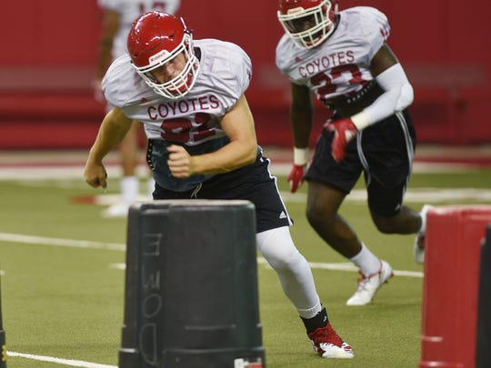 USD's Riley Peters runs drills during practice after media day Thursday, Aug 9, at the DakotaDome in Vermillion.