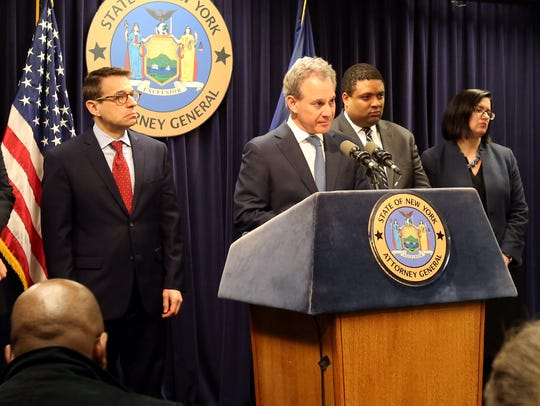 State Attorney General Eric T. Schneiderman, center, announces corruption charges against Mount Vernon Mayor Thomas during a news conference Monday in Manhattan.