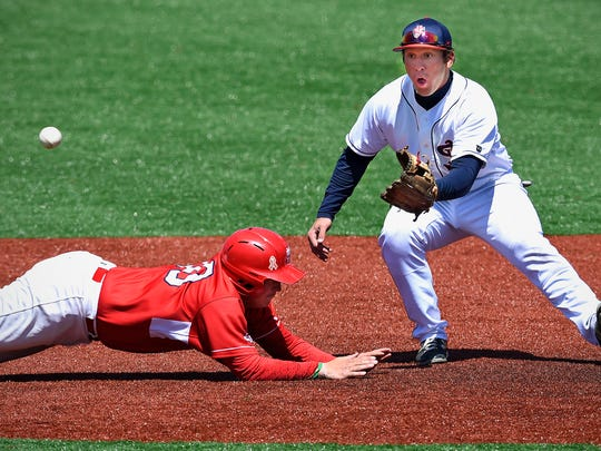 Logan Hershey of St. John's tries to make a pickoff play on Dirk Drohner of St. Mary's during Saturday's MIAC conference championship game at Becker Park in Collegeville.