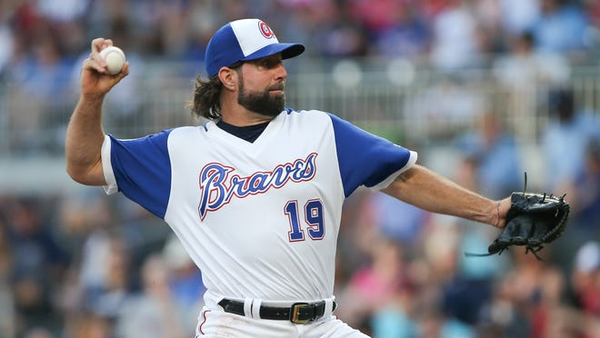 Atlanta Braves starting pitcher R.A. Dickey works in the first inning of the team's baseball game against the Cincinnati Reds on Friday, Aug. 18, 2017, in Atlanta. (AP Photo/John Bazemore)